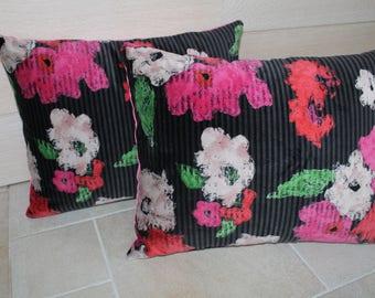 Black and fuchsia floral velvet cushion