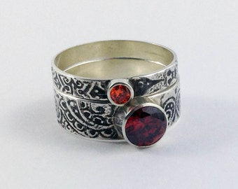 The Autumn Stack ring set in garnet and topaz coloured stones and paisley patterned band