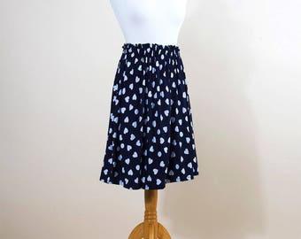 Blue skirt with polka dots and hearts