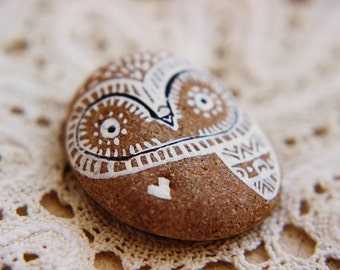 Hand painted pebble.