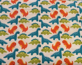 Dinosaurs on White Brushed Cotton Flannel Fabric Metre