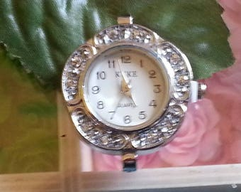 1 watch with rhinestone encrusted dial Platinum 33mm diameter hole 1 mm