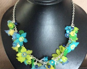 Necklace silver, lucite flowers in shades of blue with green leaves
