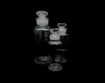 Three antique glass apothecary bottles, 19th century