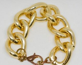 Large gold tone link bracelet