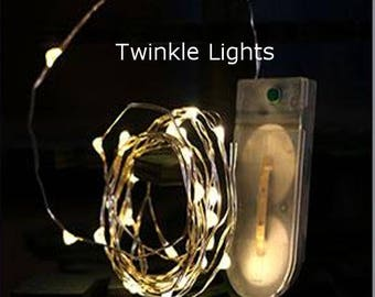 20-inches, 10 Twinkle Fairy Lights on Copper or Silver Wire. Perfect for Firefly Mason Jar Designs.  Uses 2 CR2032 Batteries (included).