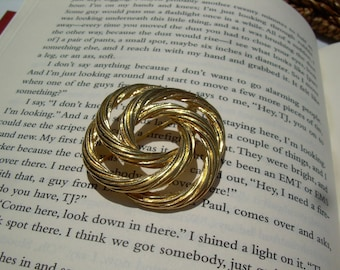 Vintage Gold tone  Monet Twisted knot brooch Beautiful for scarf, sweater, or a lovely Hat