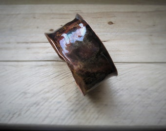 Copper bracelet with patina and silver rivets