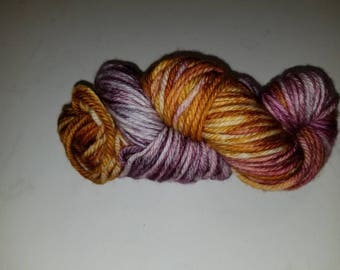"Royalty, s hand-dyed superwash merino wool bulky weight yarn. 137yds/100gms/hank. 3-3.75sts=1"" on #10-11 needles."