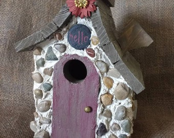 Stone birdhouse with hanger and easy clean out.  Durable and made in Michigan. Fast shipping!