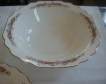 3 matching bowls one is 8 inches, 2 are 9 inches in diameter with lovely floral design and silver edge.