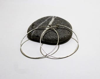 Skinny Round Sterling Silver Hoop Earrings 5cm With Hammered Texture Made In The UK by Lady C Jewellery