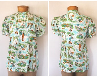 Vintage 1970s Womens Button-Front Yoked Short Sleeved Blouse with Novelty Childrens Print Size S/M