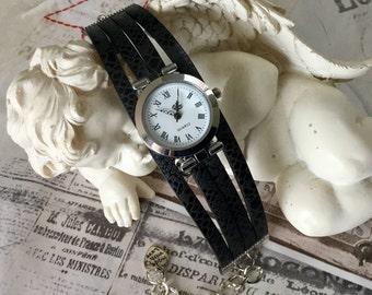 Wristwatch woman size UNIQUE round silver black
