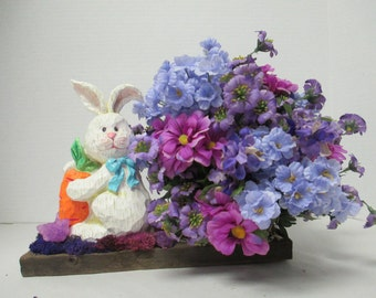 Easter floral arrangement on barn wood with Easter Bunny and purple and blue silkflowers ooak