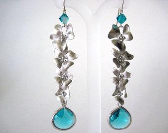 very long teal flower earrings