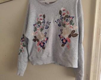 Gray sweater w/flowers size medium