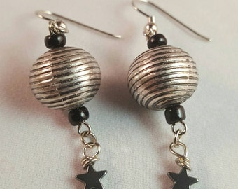 Black and silver earrings with a dangling hematite star bead