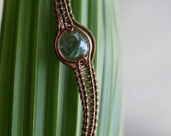 """Wire wrapped marble- clear. """"Orb of Upsidedownness"""""""