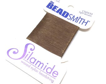 BeadSmith Silamide. Waxed Nylon Bead String. Size A. Stringing Supplies. Beadweaving Thread. Beading Thread. Light Brown. 40 yards. One (1).