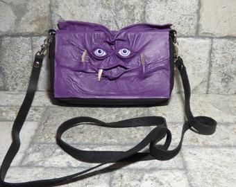 Portemonnaie Cross-Body mit Gesicht kleine Monster lila schwarz Leder Tragriemen Cabrio 394