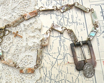 religious assemblage necklace upcycled jewelry found object repurpose neutral catholic medal