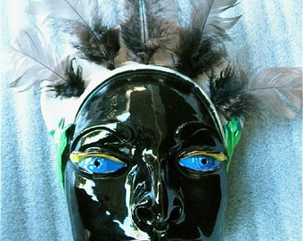 Night Spirit Ceramic Wall Mask with feathered headdress.