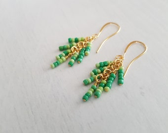 Green beads, wire wrapped, gold plated cluster earrings.