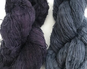 Two complementary 250g skeins of laceweight mohair yarn, hand-dyed with logwood chips