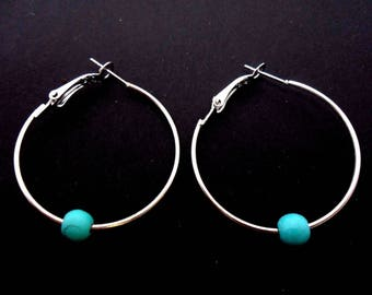 """A pair of silver plated 35mm 1.5"""" hoop and turquoise bead earrings."""