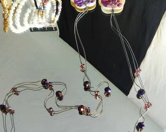 Shell earrings with purple crystals