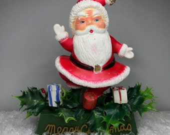 vintage plastic Santa with presents and holly