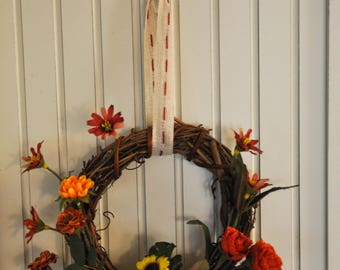6-Inch Grapevine Wreath with Sunflowers, Marigolds, Zinnias, and Red & Orange Flowers