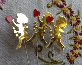 Vintage Set of Three (3) Cupid with Arrow and Heart, Red and Gold, Plant or Cupcake Picks, Plastic