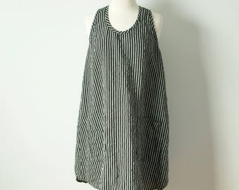 shorter flowing a-line large black and white striped linen dress with pockets racer back and shirt tail hem