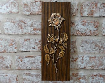 Vintage faux teak and brass wall hanging roses