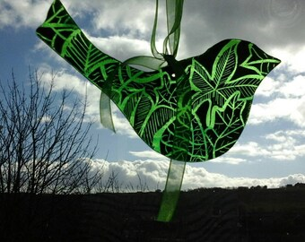 Glass bird with leaf design. Handmade.