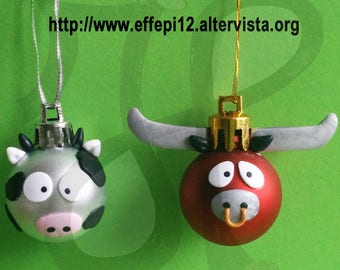 Ball to decorate the Christmas tree with cow and bull