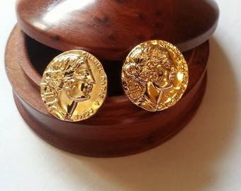 New elegant gilded stud earrings made of buttons.