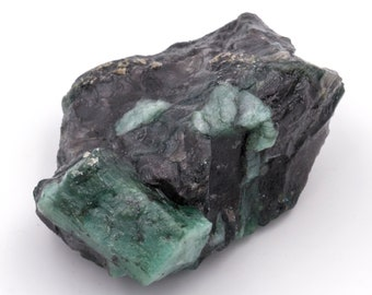 Raw emerald stone of 87 grams with matrix of black mica and quartz.