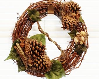 "10"" Grapevine Wreath with Pinecones, Acorns, Twigs, Vines and  Pebbles with Imitation Philodendron & English Ivy and Authentic Spanish Moss"