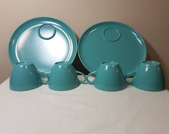 Melmac cups and plates. 4 coffee or tea cups and 2 plates.