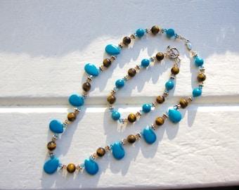 Turquoise, tiger eye, swarovski crystal, sterling silver necklace & bracelet