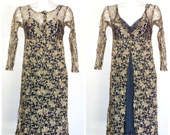 Black and gold lace dress with empire waist and long sleeves