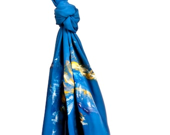 Hand-painted blue silk crepe scarf.
