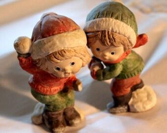 Snowball throwing children figurines