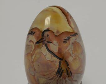 vogel gravure in steen