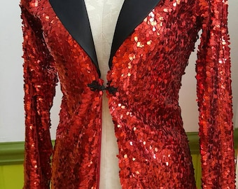 Red stretch sequin jacket with black cuffs and collar  designed by LOLITA ALONZO