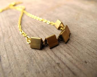 raw brass triangle necklace