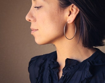 "Large silver hoop earrings with a modern satin finish, a classic large hoop, elegant jewelry staple for women - ""Hammered Tail Hoops"""